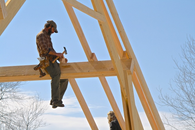 Farmer David, readying a rafter.