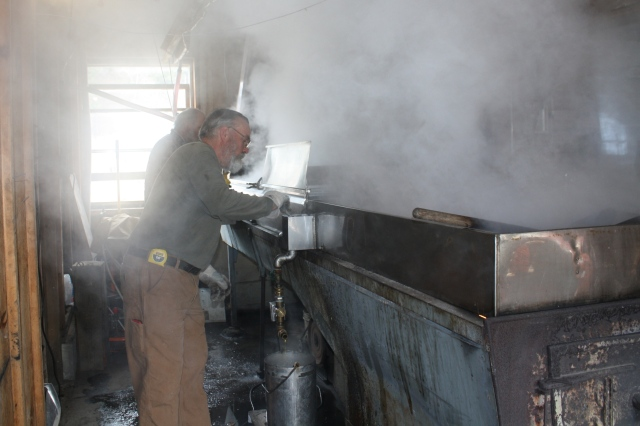 Howard tending the evaporator - the humid air smells sweet!