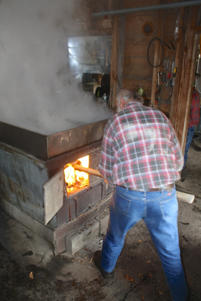 Adding wood to the fire.