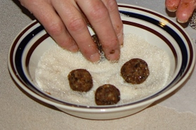 Roll balls in unrefined sugar or finely shredded coconut