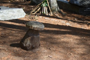 Carved toadstool seat in Fairy Garden